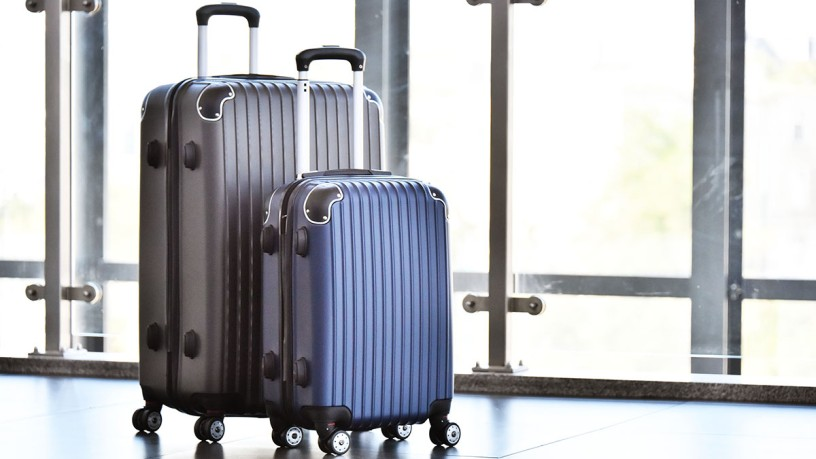 Two suitcase standing alone, link to Arrival at aquanale