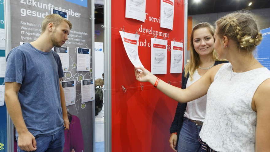 gamescom visitors in front of a notice board with job offers