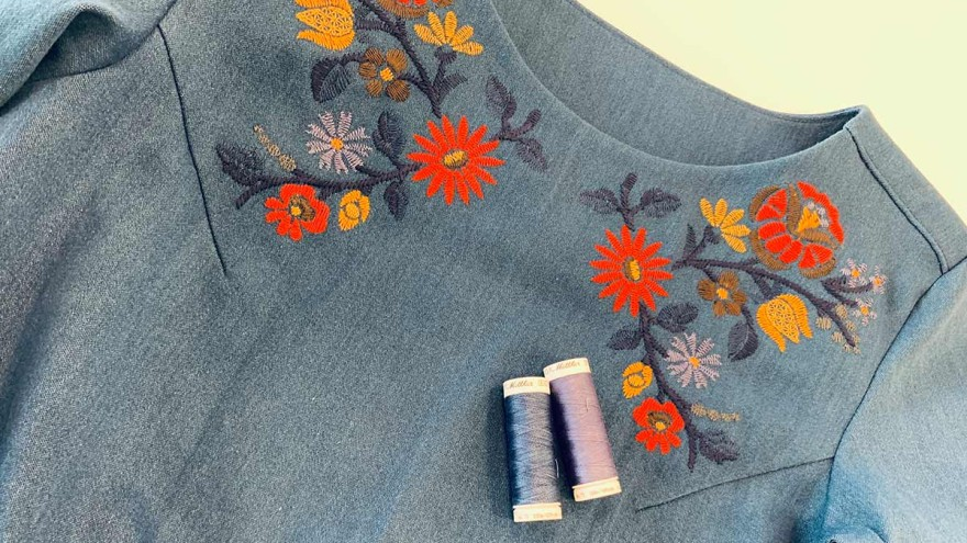 Denim dress with flower embroidery on the neckline