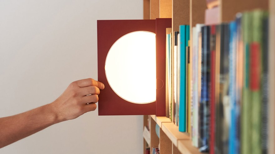 Elina: a bookend that doubles as a table lamp or a reading light on the shelf.