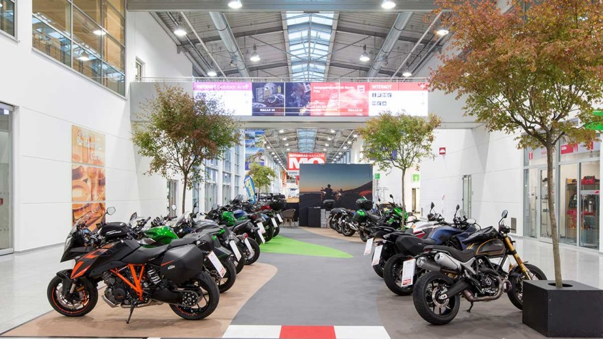 View of the boulevard with exhibited motorcycles in the halls of Koelnmesse