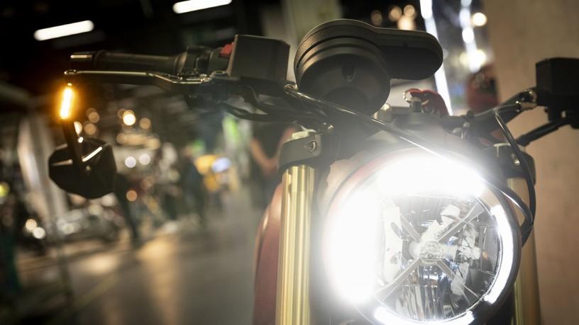 Close-up of illuminated motorcycle headlights